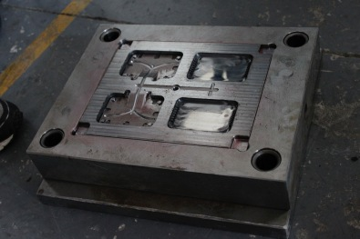 Injection-side mold - molten plastic flows through the runners and enters through gates and into the cavity.